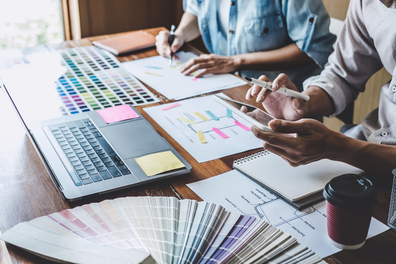 team-of-creative-webgraphic-designer-planning-HWVH5SK